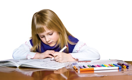 Cute young girl drawing with markers