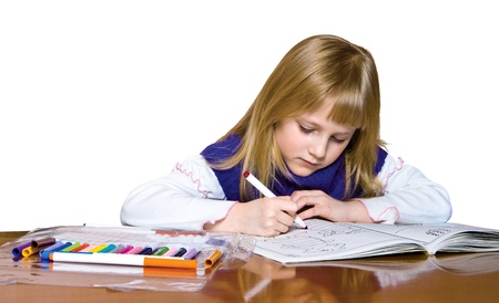 Cute young girl drawing with markers. Stock Photo