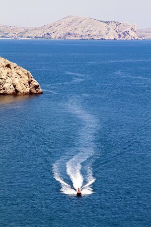 jetski racing on a blue water background