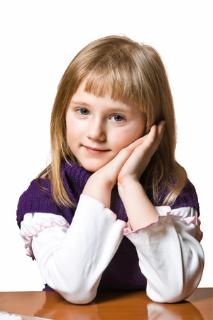 Pretty blond little girl. Isolated on white background