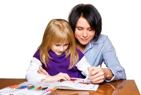 Mother and daughter drawing in the book, isolated on white Stock Photo