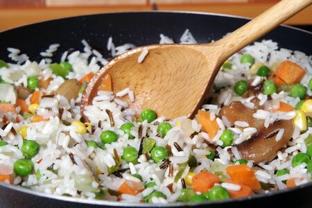 fried rice with vegetables in a skillet photo