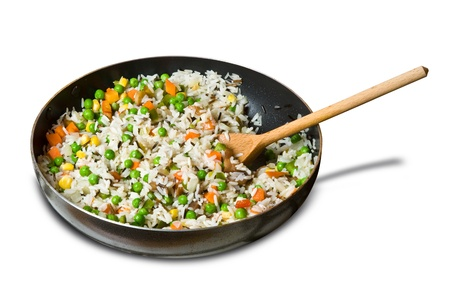 fried rice with vegetables in a skillet, isolated on white Stock Photo - 9898188