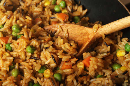 fried rice with vegetables and spices, close-up photo