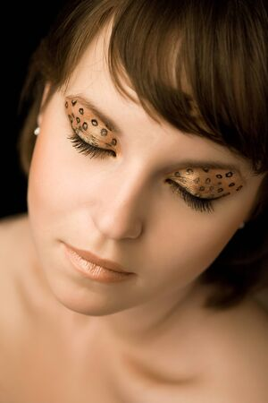 Portrait of the woman with the golden make-up Stock Photo