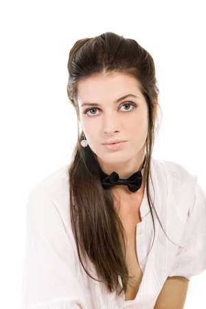 Pretty young woman in white shirt on white background