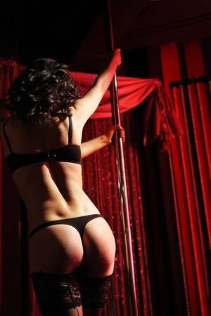 Sexy girl dancing strip-tease in the nightclub  Stock Photo - 9898126