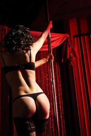 Sexy girl dancing strip-tease in the nightclub Stock Photo - 9898126