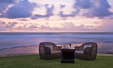 Romantic dinner on the ocean coast at sunset Stock Photo