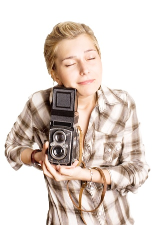 young pretty girl with old photocamera Stock Photo
