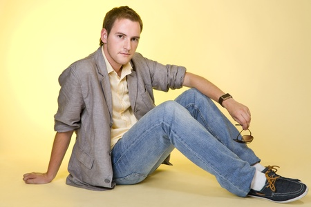 Portrait of a casual young man sitting relaxed.