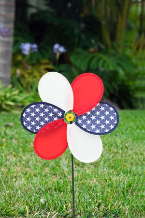 pinwheel with the U.S. symbol on green grass