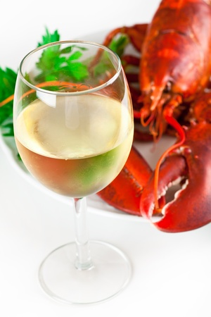 Glass of white wine with cooked lobster on the plate, top view Stock Photo