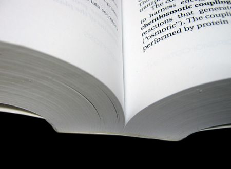 open book on black background Stock Photo