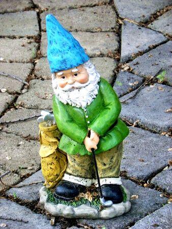 dwarf playing golf Stock Photo