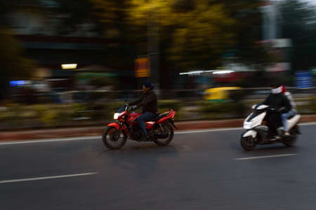Panning technique of two biker going to work at morning on the road