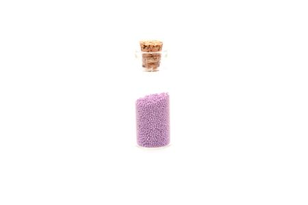 Glitter (little balls) in small glass bottles
