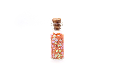 Glitter (small figurines) in small glass bottles with corks