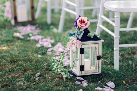 outdoor wedding: Wedding lantern with candle on a beautiful lawn Stock Photo
