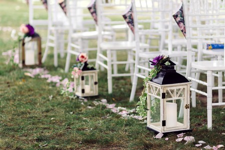 table decoration: Wedding lantern with candle on a beautiful lawn decorated with a flower