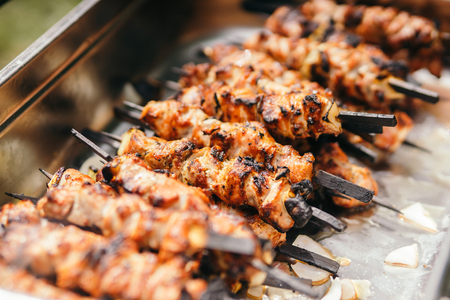 Marinated shashlik lies cooked on a barbecue grill. Shashlik or Shish kebab popular in Eastern Europe.