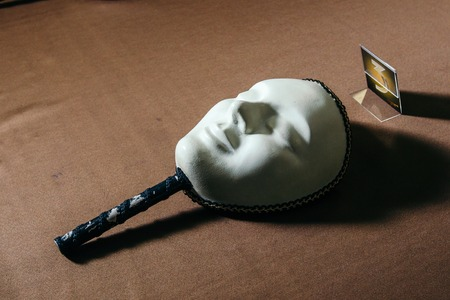 jalousie: White mask for playing in the mafia on the table.