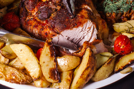 Beef thigh with rosemary and potatoes.