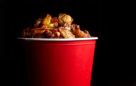 Chicken legs in a bucket.