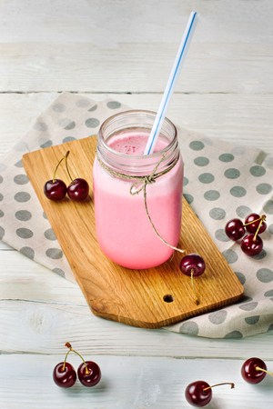 Cherry cocktail with berries. Stock Photo