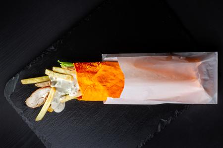 Shawarma sandwich, Doner Kebab in an orange cake. Imagens - 120897896