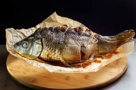 Carp stuffed with baked fruit, sewn with thread.