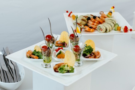 On a beautiful white square plate lined with snacks. Stok Fotoğraf