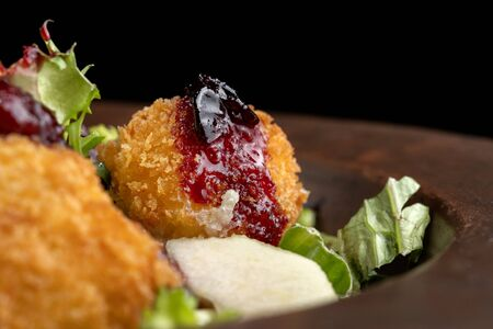 Tasty Homemade Cheese Donuts Jam, poured with pear and salad.