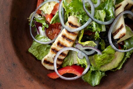 Fresh salad with grilled cheese, tomatoes, olives, lettuce and arugula-2.