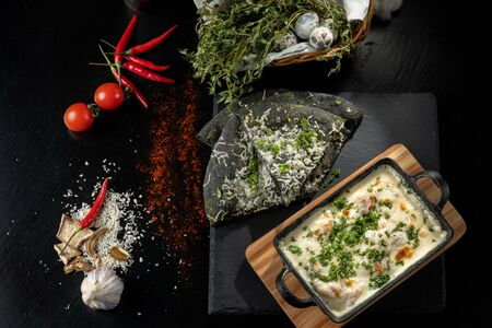 Cheese casserole with chicken and herbs. Beautiful baked crust. Stock Photo
