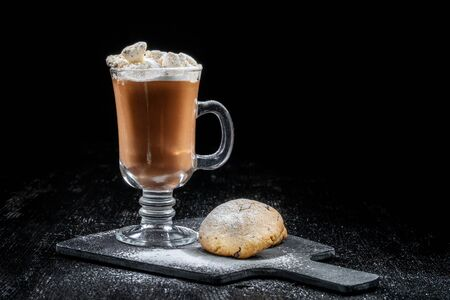 Chocolate dessert, hot chocolate with slices of ice cream, two livers lie nearby. Stock fotó