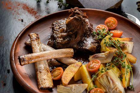 Ethically raised, fresh cut organic rib eye steak grilled with fried potatoes. Banco de Imagens