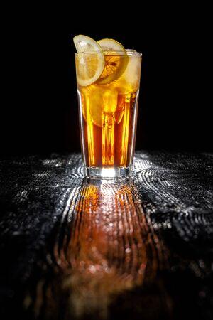 Long island ice tea. Standing on a varnished black table. Reklamní fotografie