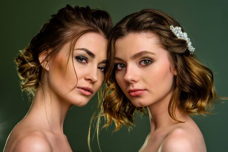 A group of young beautiful girls. Two women face close-up. Stock Photo