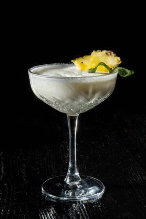 Cocktail Pina Collada. Garnished with a slice of pineapple.