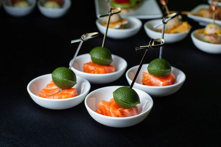 Smoked salmon canape with mousse, bonded with bamboo sticks.