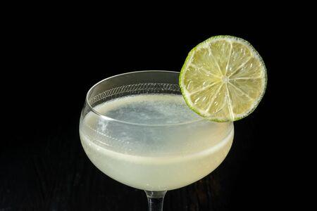 Classic daiquiri on the dark background. Luxury craft drink.