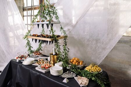 Catering, a wedding table with champagne, fruits, snacks.