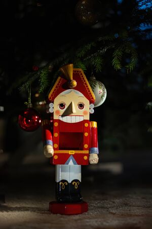 Nutcracker under the Christmas tree, clouse-up.