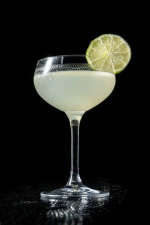 Classic daiquiri on the dark background. Luxury craft drink.