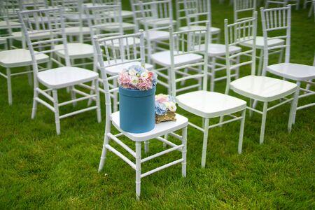 Chiavari chairs on grass. Diagonal composition.