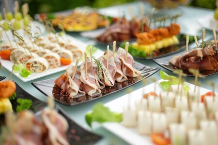 The classic Spanish hamon. Food delivery service and catering meals on the table during the event.