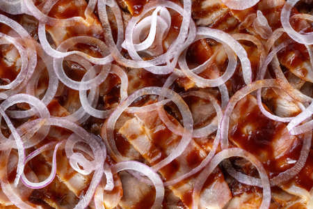Fresh baked homemade pizza with bacon and onions, Oregano and tomato sauce.
