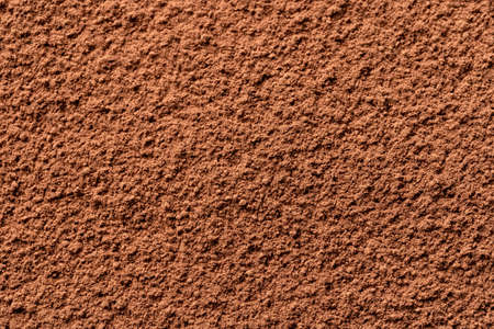 Cocoa powder background, top view. Good contrast light.