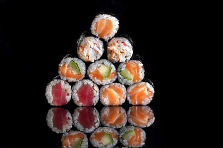 Rolls with salmon, rice, nori, fresh salmon. A pyramid of rolls. Standard-Bild